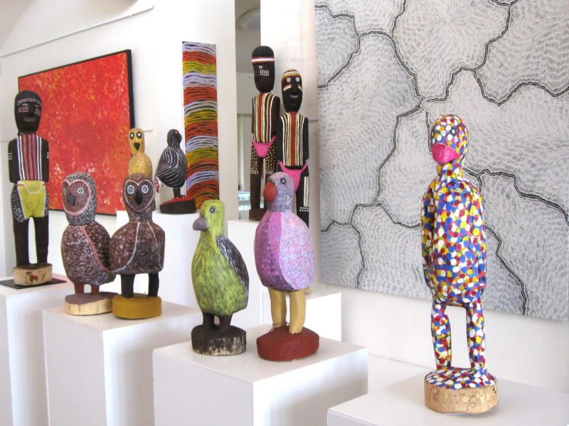 Large carved birds and ceremonial figures by Utopia artists, Aboriginal art paintings.