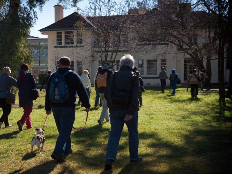 Tour participants walking up to a historic building