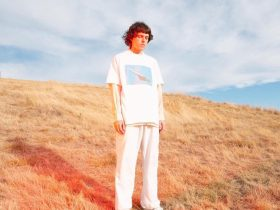 Photograph sows Allday standing on a dry grassy hill