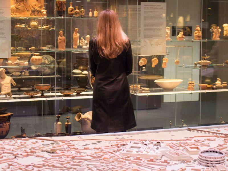 Woman admiring museum artefacts