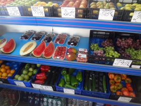 Wide variety of fresh, seasonal produce being sold.