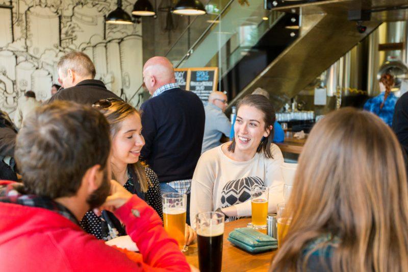 People having beers in the downstairs bar