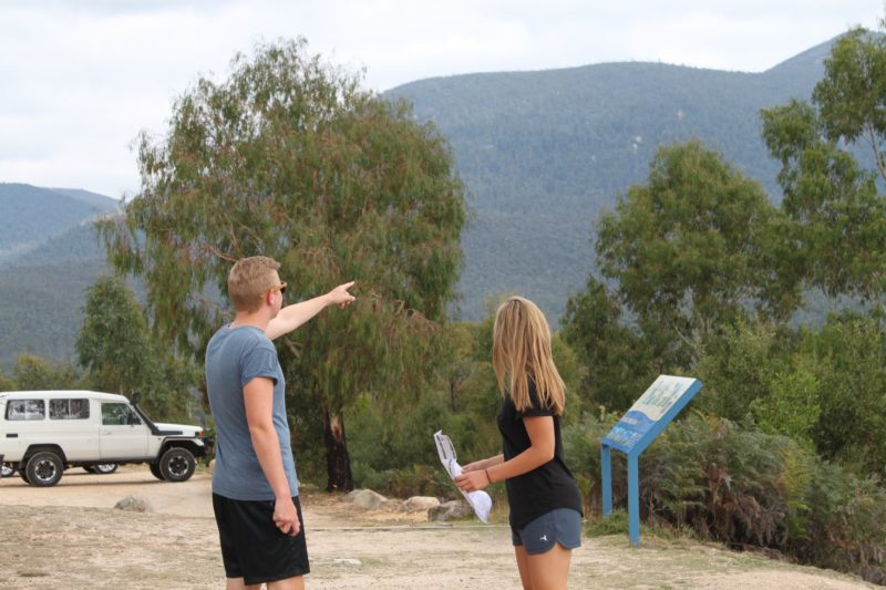 Man pointing towards mountain at Tidbinbilla Nature Reserve