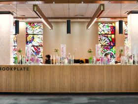 Modern wood and stained glass windows create a warm and welcoming environment