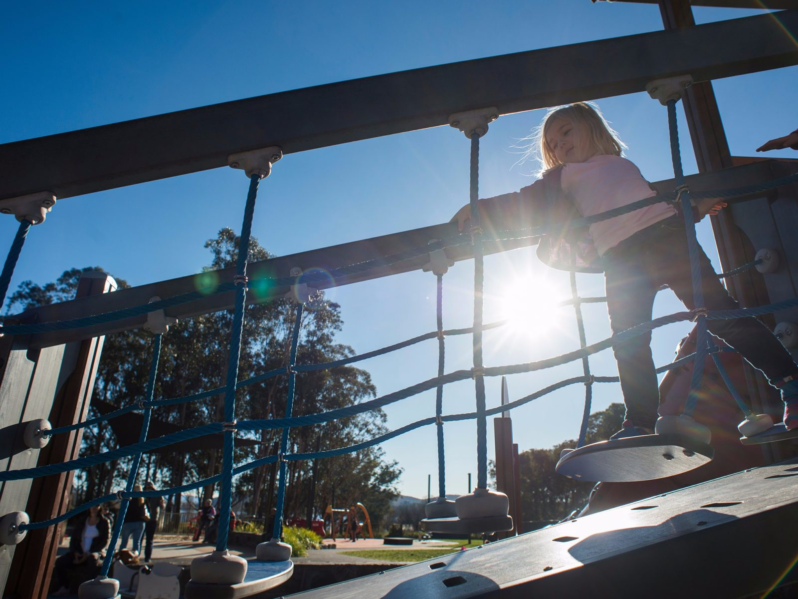 Girl on a moving bridge in the Boundless Playground