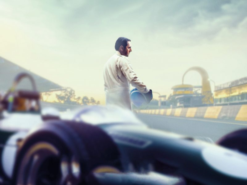 Brabham film poster image of driver at racetrack.