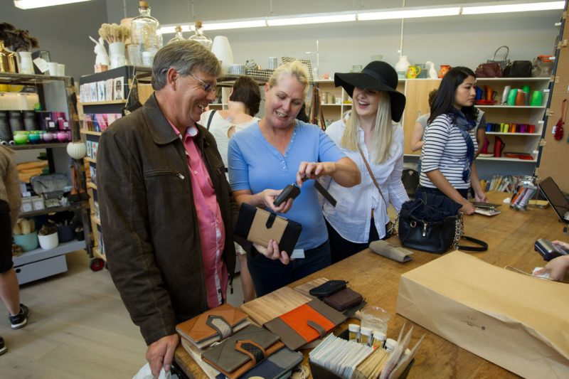 Customers buying designer handcrafts and gifts