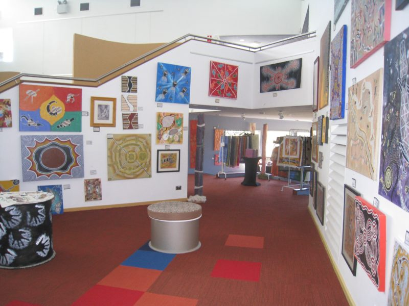 Artwork on display on the walls to the right of the staircase