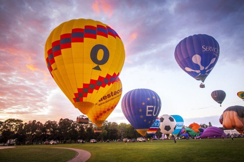 Balloons rising into the sky as dawn breaks