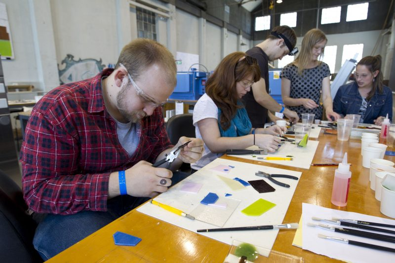 People making tiles at an Off The Street class