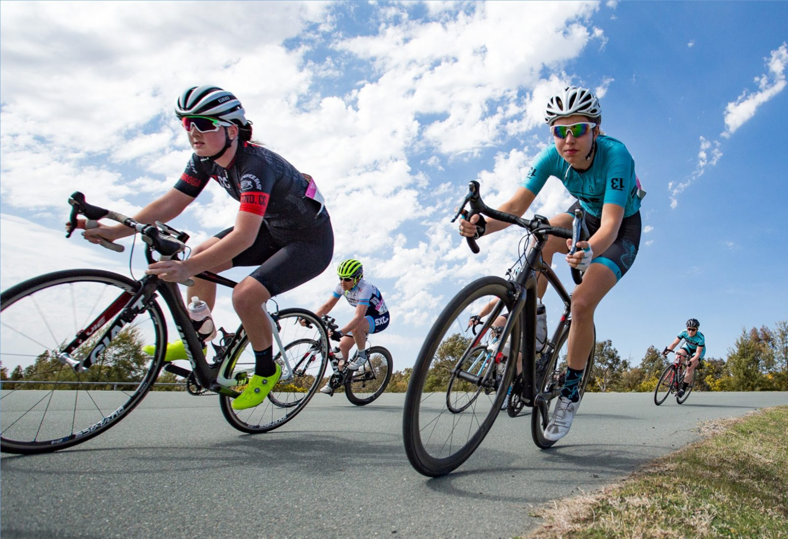 Female cyclists taking a corner on the Criterium track at Stromlo Forest Park