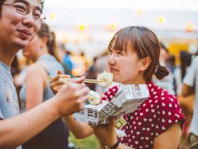 Young couple share dumplings.
