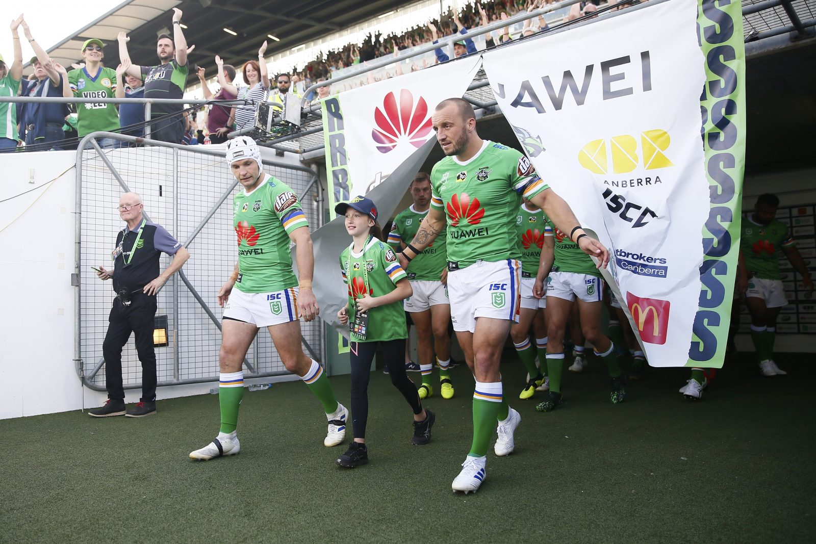 Captains Josh Hodgson and Jarrod Croker lead out the Canberra Raiders