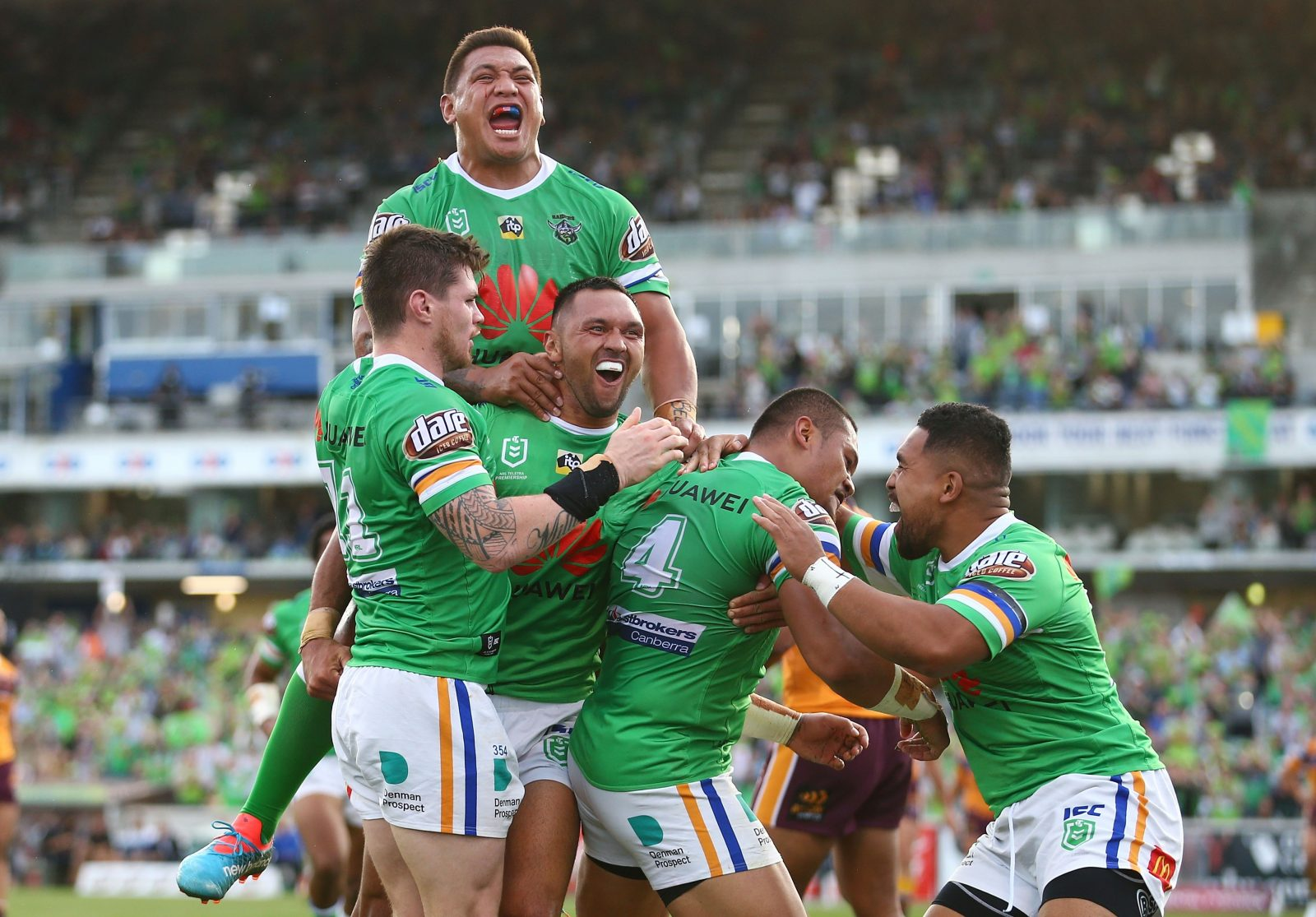 Canberra Raiders players celebrate a try