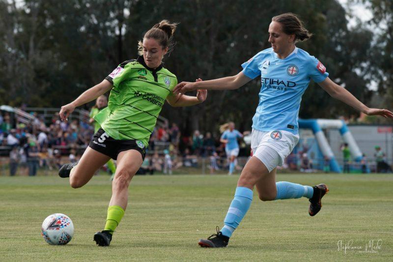 Nikola Orgill battles a Melbourne City player for the ball