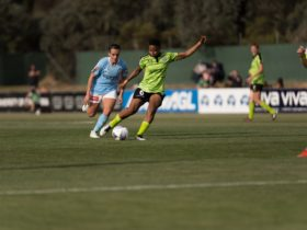 South African Star Refiloe Jane takes a shot as Melbourne City watch on