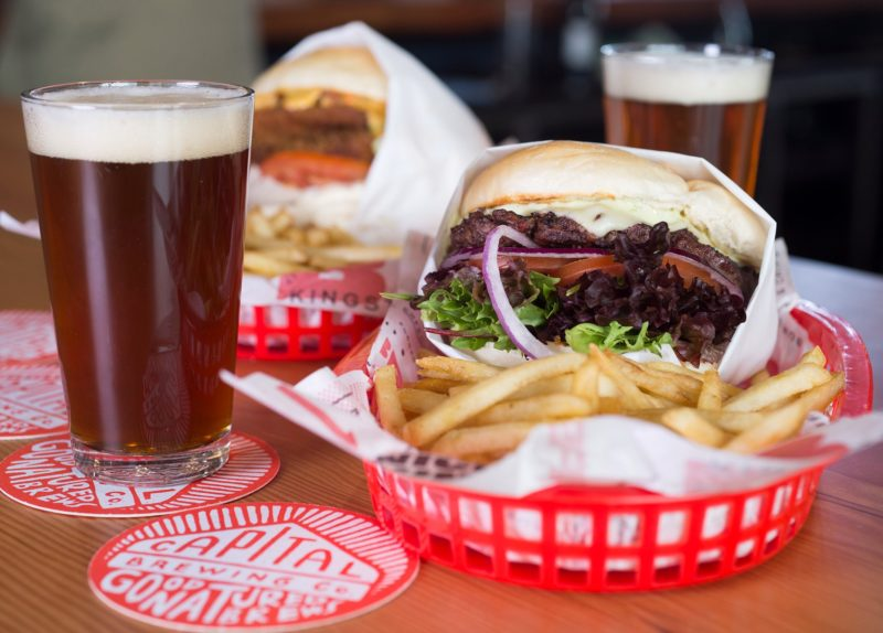 Beer and two burgers with chips