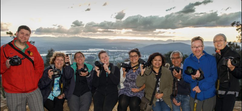 Smiling Capturing Canberra Photo group atop Mt Ainslie