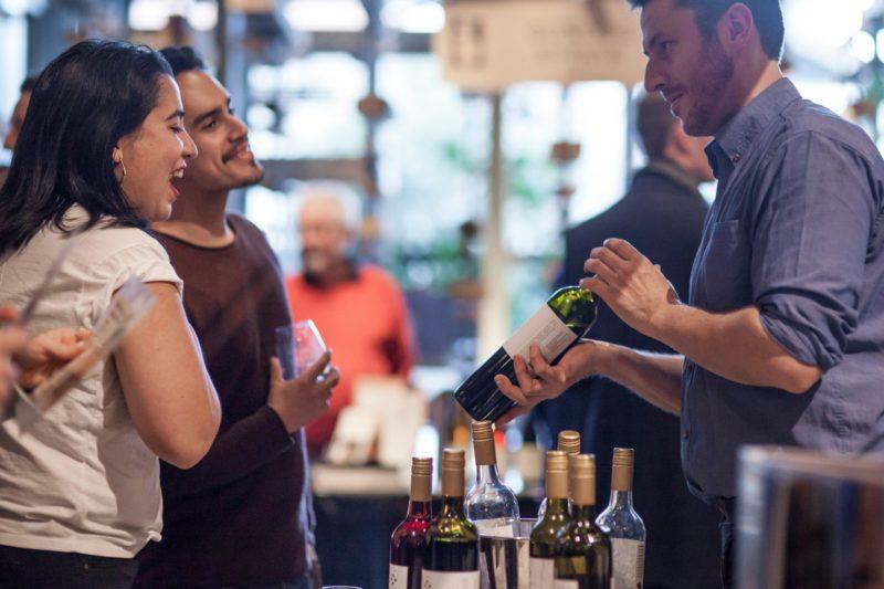 Winemaker showing wine