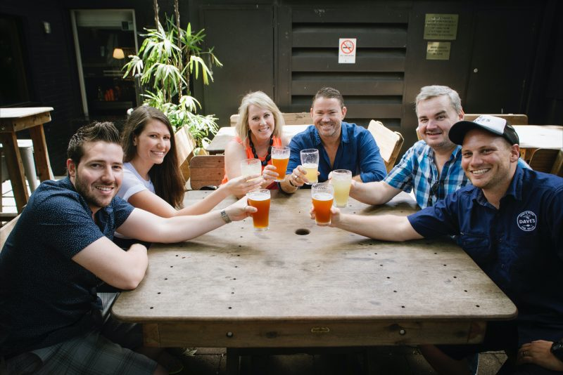 Tour participants with a cold beer