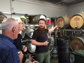 Men in the barrel room at Wig & Pen