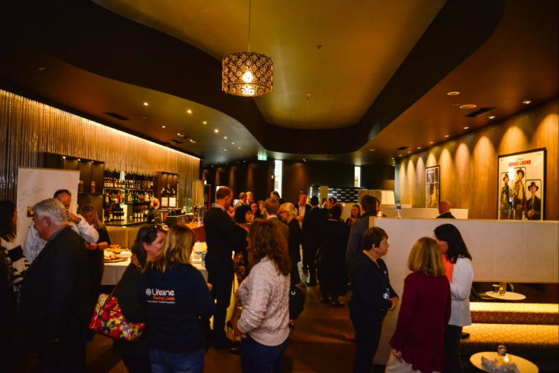 Patrons gather in the premium lounge bar before a movie