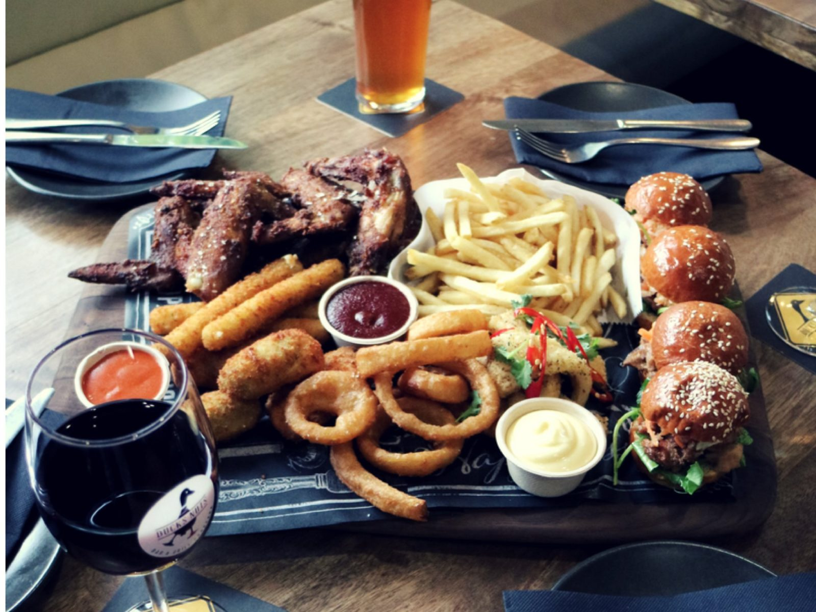 Ducks Platter with burgers, fries, chicken wings, and assorted fried foods