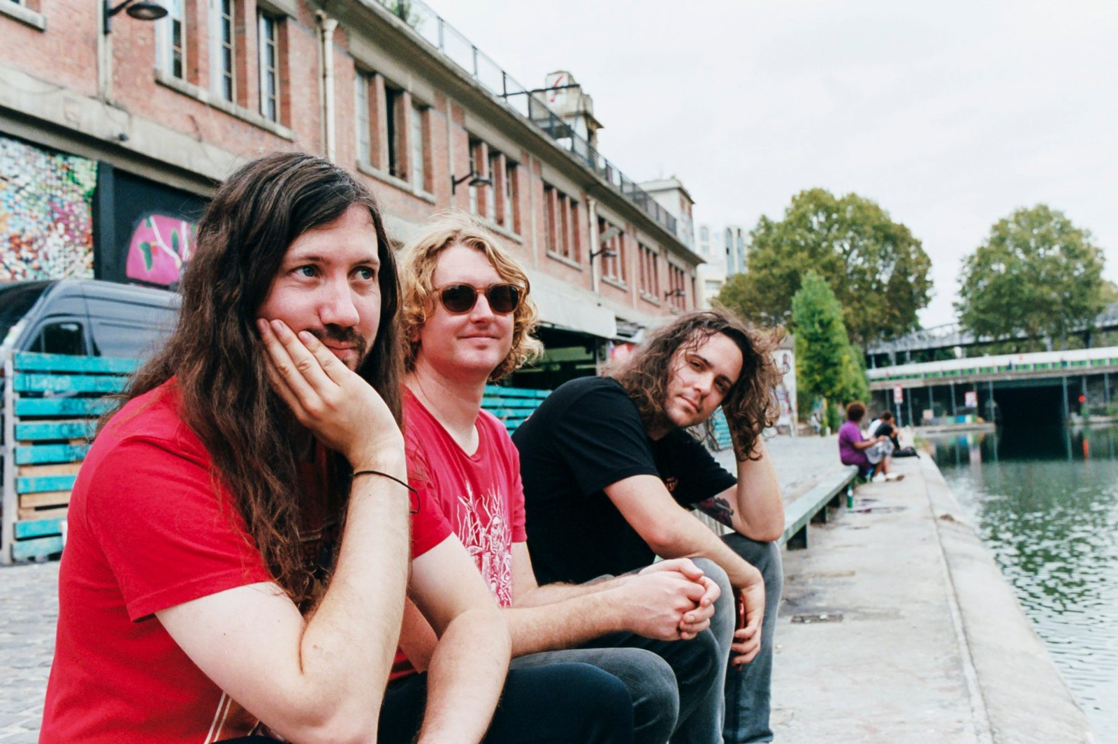 All members of DZ Deathrays sitting in scenic location