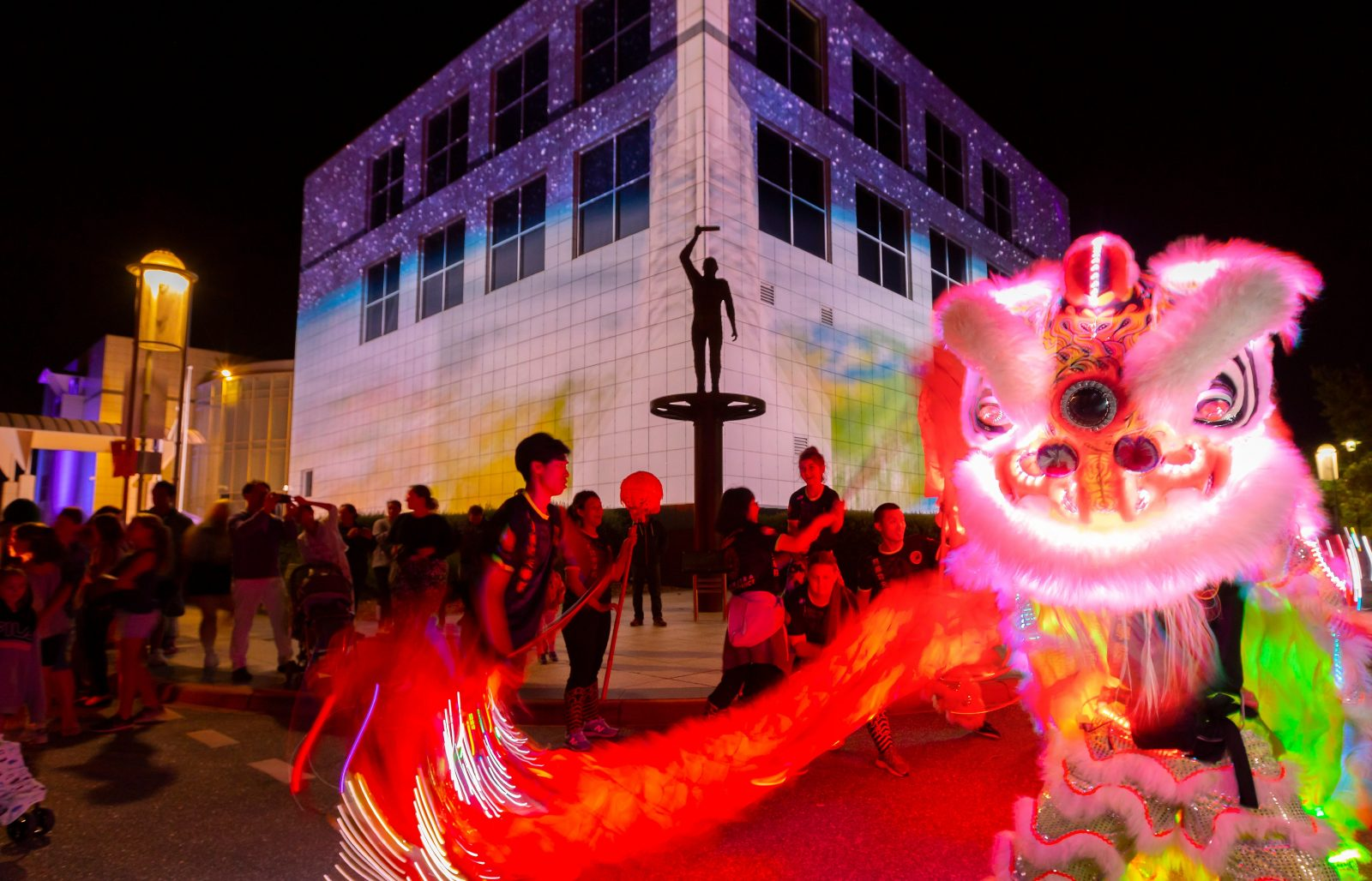 Questacon illuminated with Chines dragon dancers