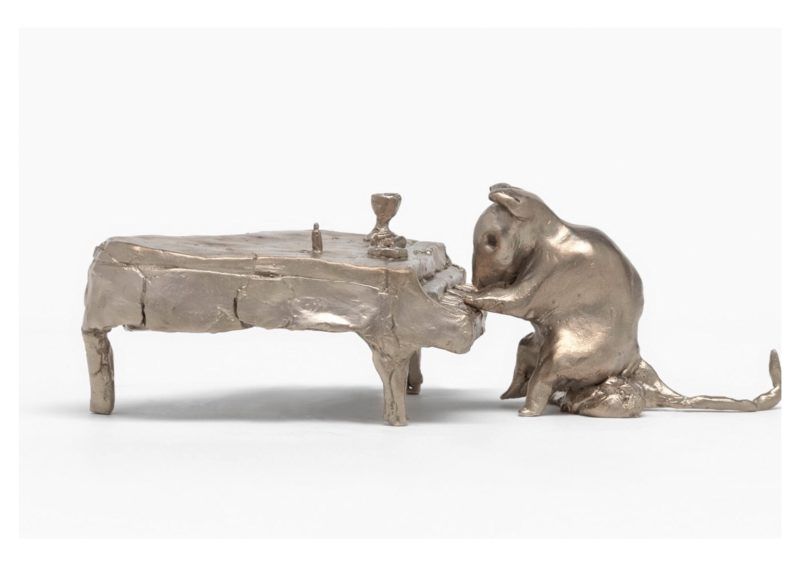 A cast bronze mouse playing a grand piano
