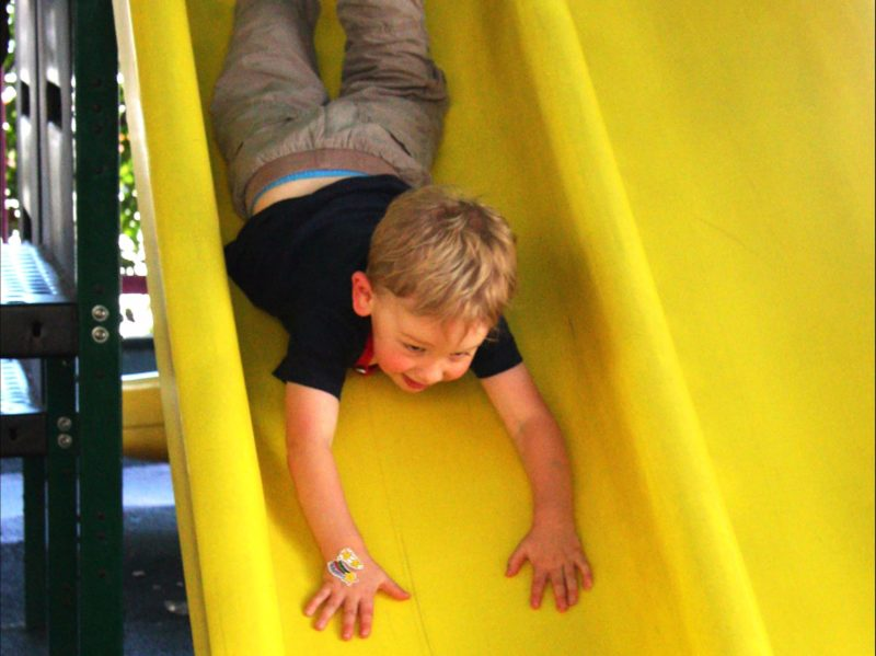 Small boy on the slide