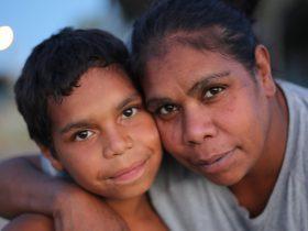 Aboriginal mother cuddling her son