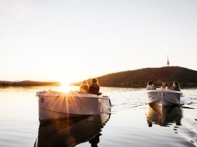 Two boats on the water at sunset