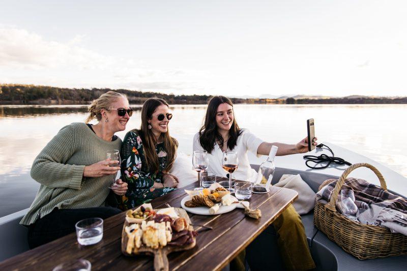Three women taking a selfie on a boat