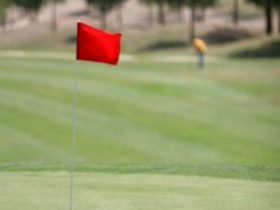 Flagstick on the putting green