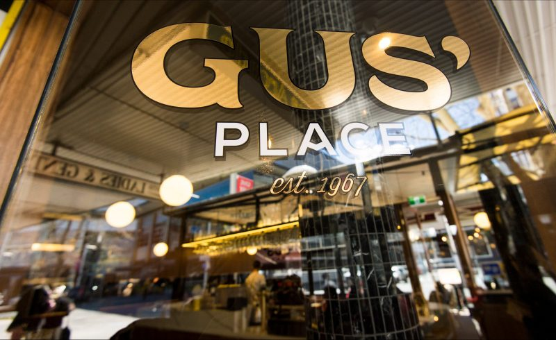 Front window with Gus' Place logo
