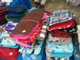 Piles of dog coats for sale