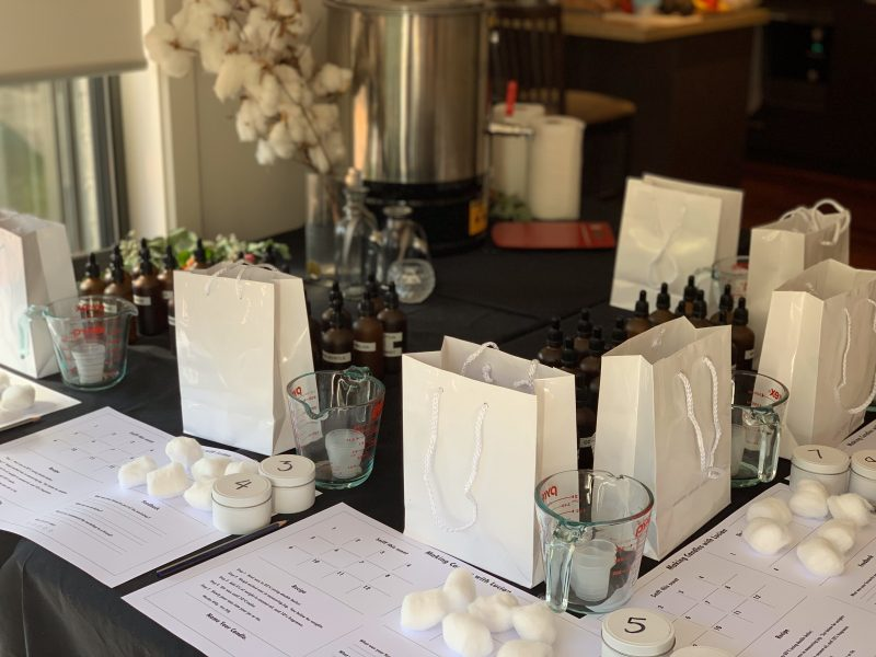 candle making workshop table settings with placemats and bags