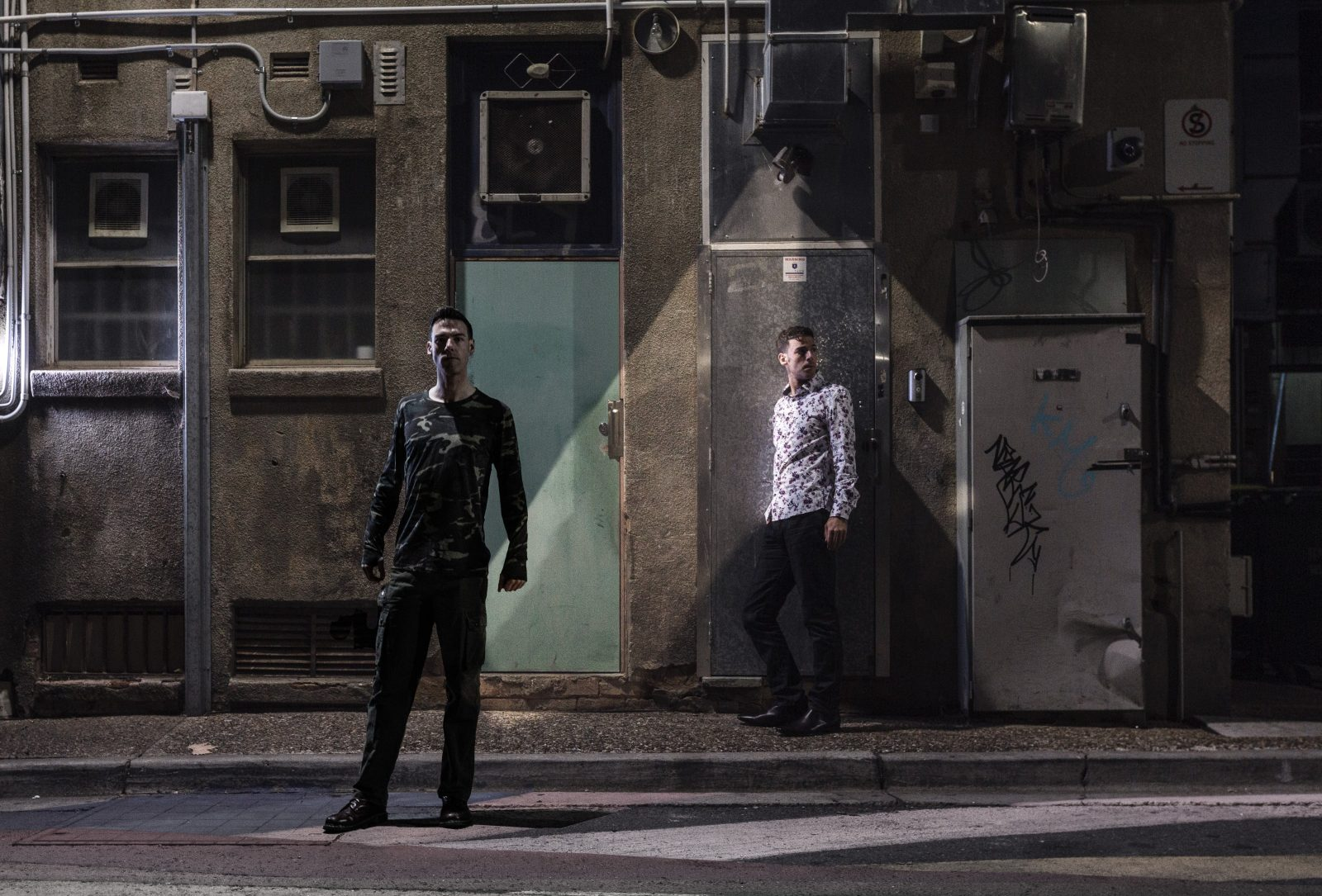 The Howie Lee and The Rookie Lee loiter in a grimey back alley.