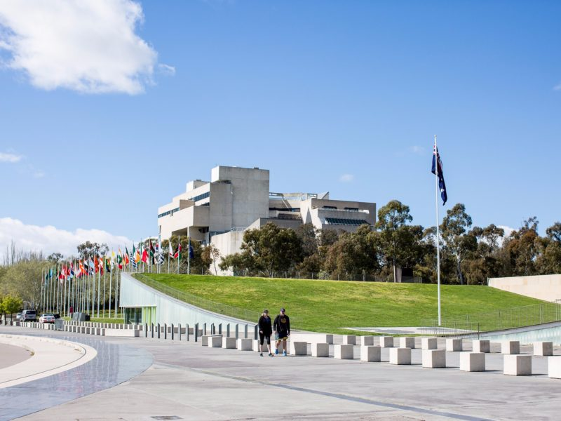 International Flag Display with the High Court of Australia in the background