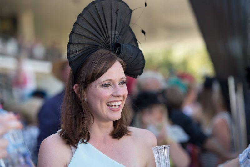 Lady wearing black facinator