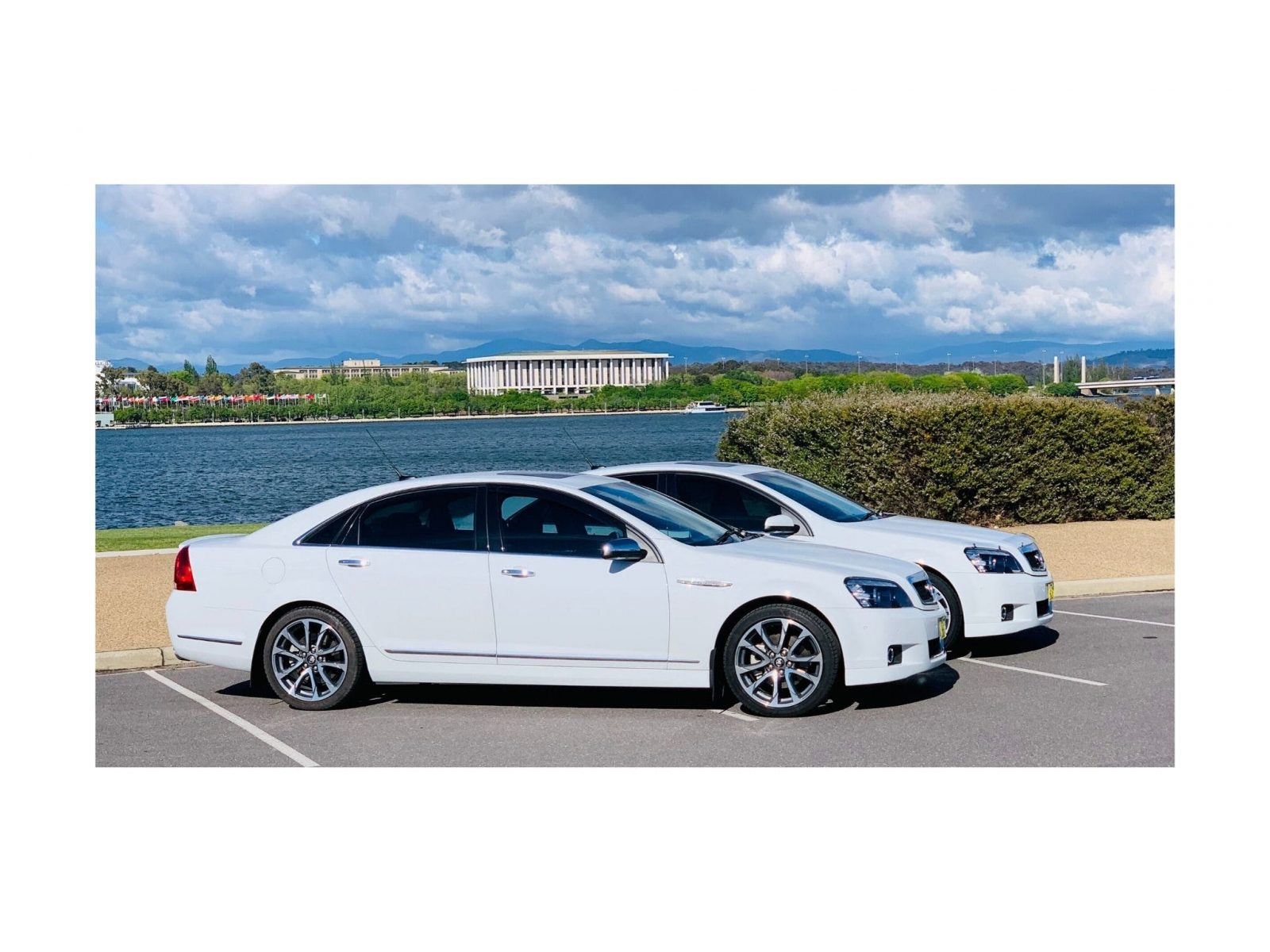 Luxury chauffeur limousines with Lake Burley Griffin and the National Library in the background