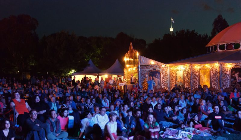 Outdoor audiences looking at the films