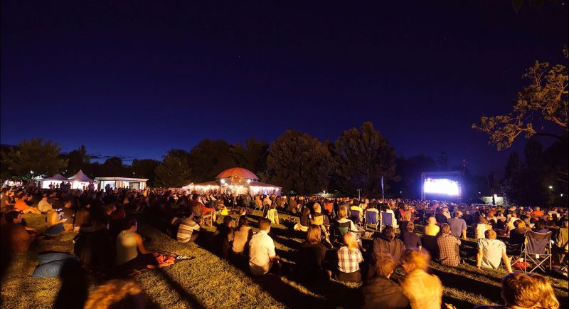 Crowds enjoying the Lights! Canberra! Action! film festival outdoors