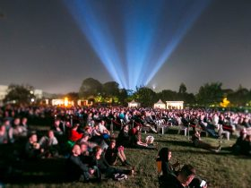 Crowd on lawns watching movies