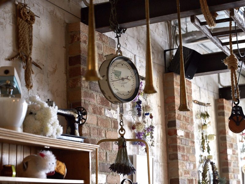 Quirky hanging objects from wooden beams and exposed brick walls
