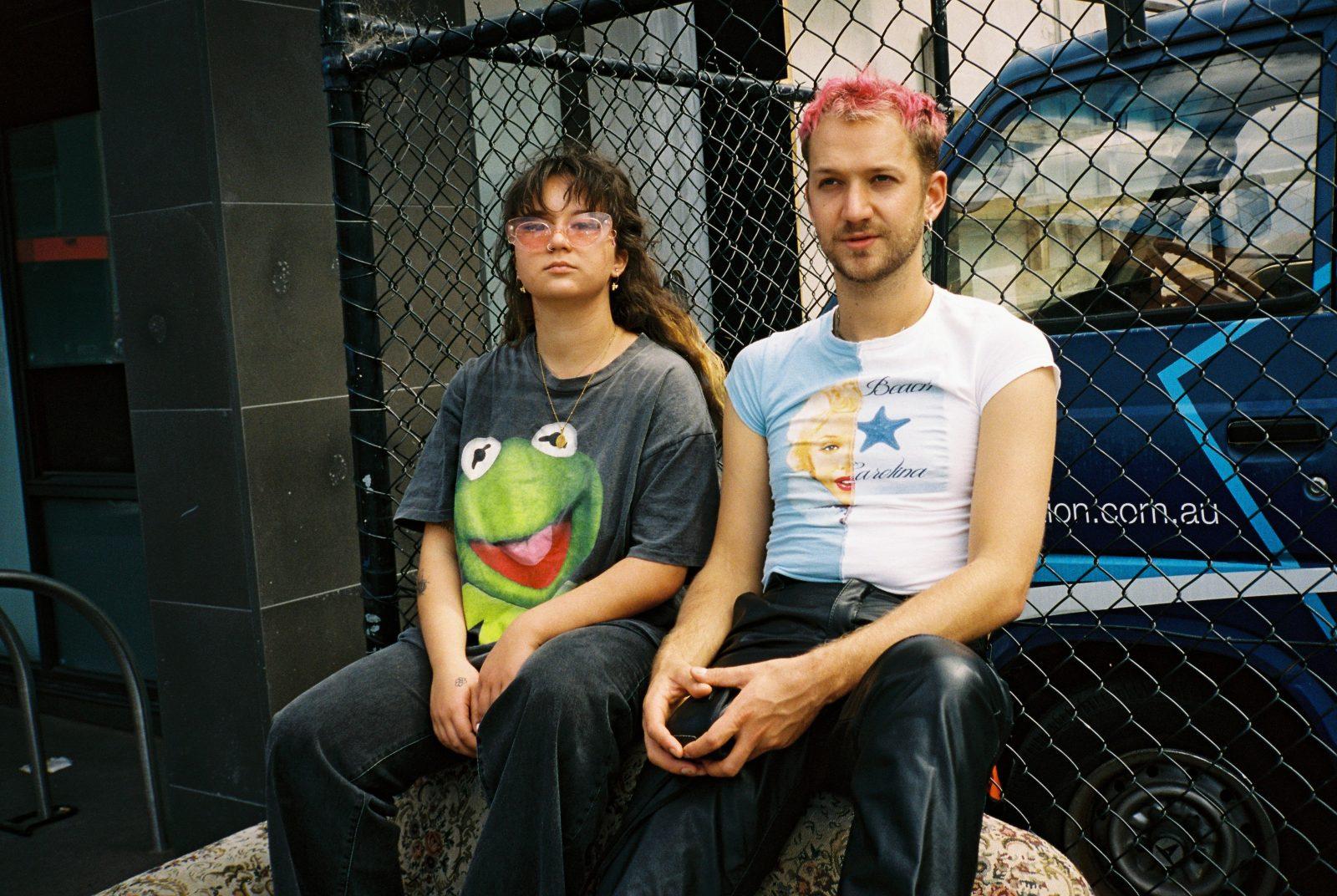 Artists Mallrat and Basenji posing in backstreet