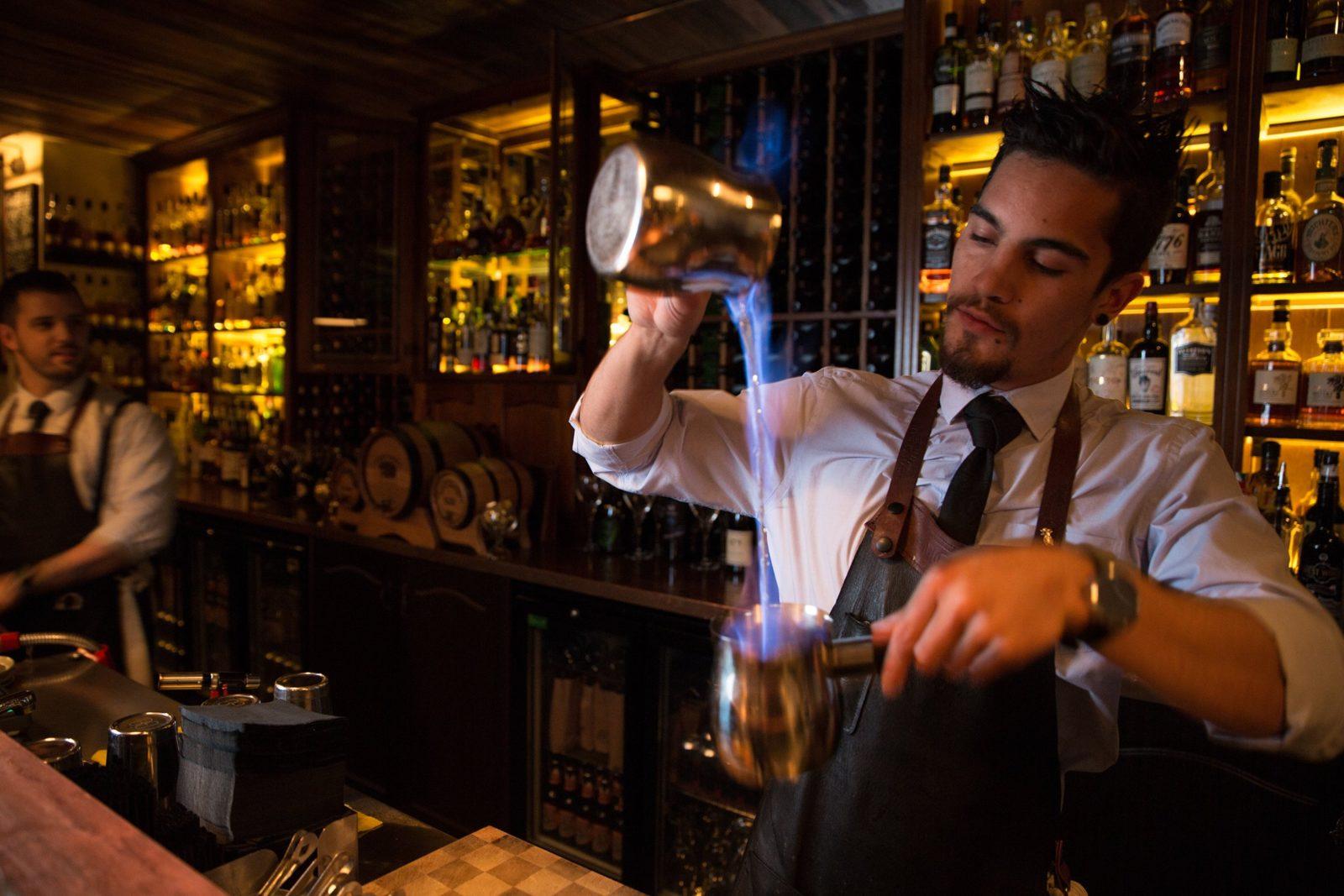 Bartender making flaming cocktails