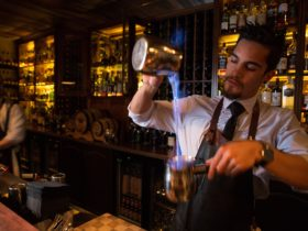Bartender making flaming cocktails