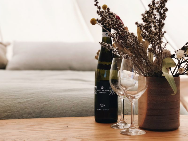 Bed, wine, flowers, wine glasses, tent